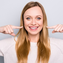 woman pointing to her teeth