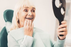 Smiling woman with regained confidence from dental implants