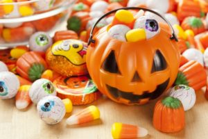 Halloween pail and candy laid out by Skokie dentist